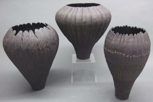 Coiled_and_carved_Basalt_Vessels-190