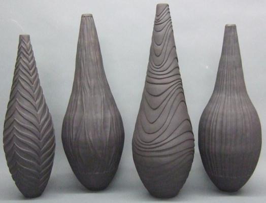 Coiled_and_carved_basalt_bottles-182